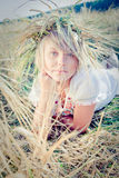 Young woman on wheat field Stock Images