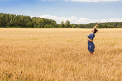 Young woman in a wheat field Stock Image
