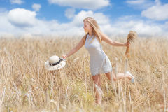 Young woman in a wheat field Stock Photos