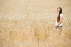 Young woman in the wheat field Stock Photography