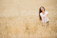 Young woman in the wheat field Stock Photos