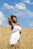 Young woman in a wheat golden field Royalty Free Stock Images