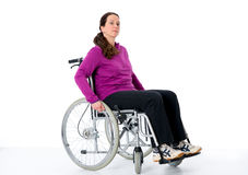 Young woman in wheelchair. In front of white background Royalty Free Stock Image