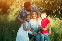 Young woman in wheelchair with her family. Family portrait royalty free stock photos