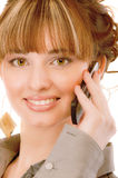 Young woman which speaks by phone stock photography