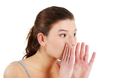 Young woman whispering. Stock Photos
