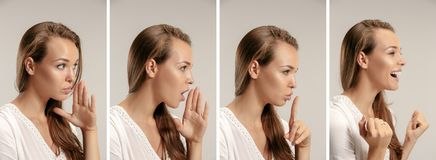 The young woman whispering a secret behind her hand. Secret, gossip concept. Young woman whispering a secret behind her hand. Business woman isolated on trendy royalty free stock photos