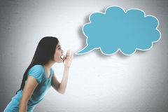 Young woman whispering to an empty cloud Stock Photos