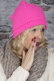 Young Woman Whispering Wearing a Pink Hat Stock Images