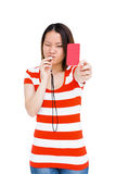Young woman whistling and showing red card. On white background Stock Photography