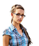Young woman on white. Girl next door, young friendly brunette with glasses in plad shirt looking at camera isolated on white Stock Photos