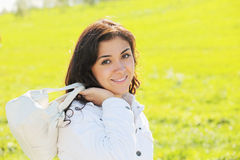 Young woman with white bag Stock Image
