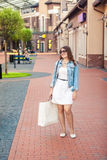 Young woman with white bag having shopping on street Royalty Free Stock Photos