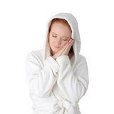 Young woman in white bathrobe Stock Image