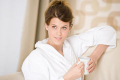 Young woman in white bathrobe with coffee Stock Photography