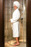 Young woman in white bathrobe. royalty free stock image