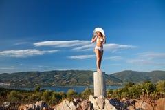 Young woman in white bikini. Beautiful young woman in white bikini Stock Image