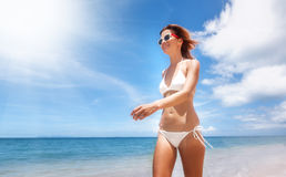 Young woman in a white bikini on a beautiful paradise Royalty Free Stock Photo
