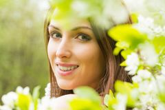 Young woman with white blossom flowers Royalty Free Stock Images