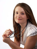 Young woman in white blouse holding bead necklace Stock Images