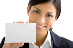 Young woman with white card. Woman smiling and showing with white card Stock Images