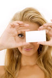Young woman with white cardboard Royalty Free Stock Photography