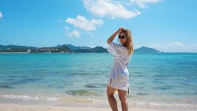 Woman in white clothing refreshing at the ocean royalty free stock photography