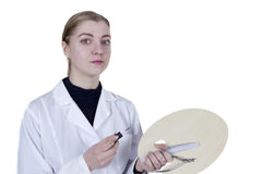 Young woman in a white coat Stock Photography