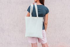 Young woman with white cotton bag in her hands. stock photography