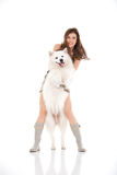 Young woman and white dog standing up Stock Images