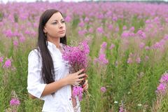 Woman in a white dress on a background of tall grass Royalty Free Stock Image