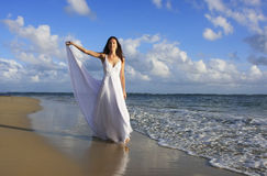Young woman in white dress on a beach Royalty Free Stock Image