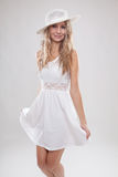 Young woman in a white dress Stock Image