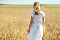 Young woman in white dress on cereal field Royalty Free Stock Images