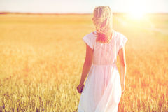 Young woman in white dress on cereal field Royalty Free Stock Photos