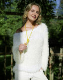 Young woman in a white dress in the countryside Royalty Free Stock Photo