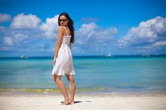 Young woman in white dress enjoy the beach Royalty Free Stock Images