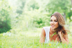 Young woman in white dress on grass Stock Photos