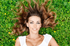 Young woman in white dress on grass Stock Images