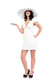 Young woman in white dress and hat Stock Photography
