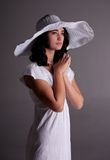 Young woman in white dress and hat Royalty Free Stock Image