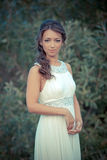 Young woman in white dress on nature Royalty Free Stock Photo