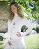 Young woman in a white dress in park Stock Photography