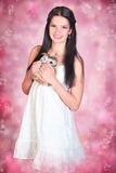 Young woman in white dress Stock Image