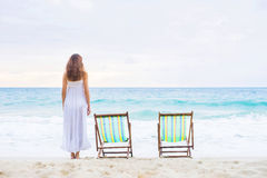 Young woman in a white dress posing on the beach Royalty Free Stock Photography