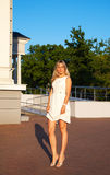 young woman in white dress posing standing in a park Royalty Free Stock Photo