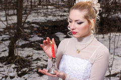 Young woman in white dress with red candle Royalty Free Stock Photo