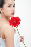 Young woman in white dress with red flower Stock Photo