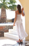 A young woman in a white dress on a resort background Stock Image