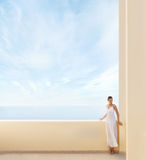 A young woman in a white dress on a resort background Stock Photography